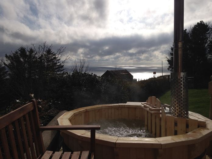 Scottish holiday cottages with hot tubs Log cabins with hot tubs scotland